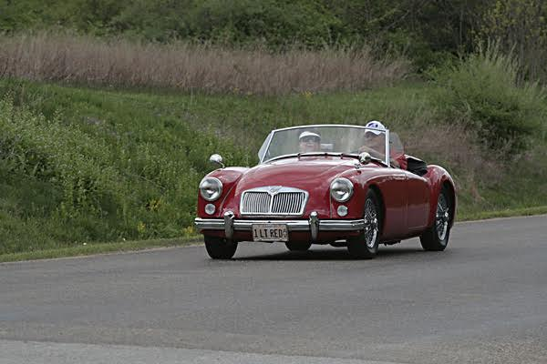 "Denny & LeeAnn Elimon, Mahomet, Illinois. 1961 MGA 1622, ""1 Lt-Red"" Have owned the car since since 1992, She has traveled to numerous gatherings and shows, great family member. We have been British car enthusiasts for years! Have owned & enjoyed MGB's, MGTD's. MGBGT's & Midgets. Active members of the North American MGB & MGA Register organizations. Founding member of the Illinois Flat Land British Car Club, past Secretary of the North American MGB Register."